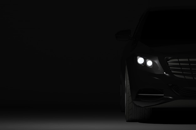 Vooraanzichtdeel van zwarte moderne autoclose-up op zwarte achtergrond, koplampendetail