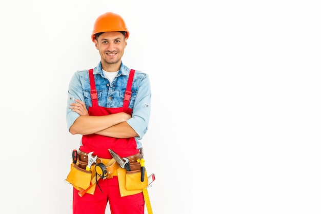 Voorraadbeeld van mannelijke bouwvakker op wit
