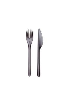 Vork en mes op wit wordt geïsoleerd dat.
