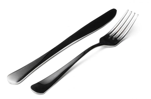 Vork en mes op witte achtergrond wordt geïsoleerd die