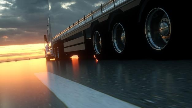 Vrachtwagen wielen close-up op asfaltweg snelweg bij zonsondergang