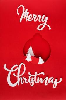 Vrolijk kerstfeest belettering en witte bomen