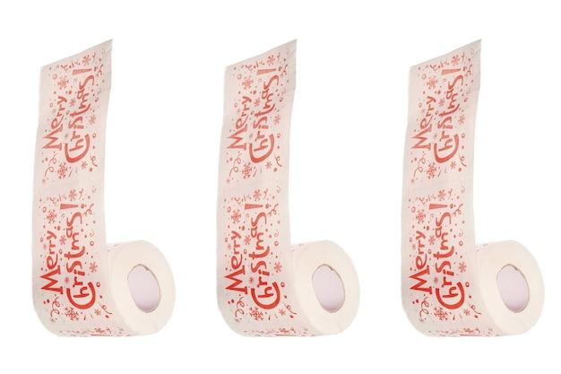 Vrolijk kerstfeest tekst op wc-papier. vakantie overeten concept. toiletpapier, geïsoleerde witte achtergrond.