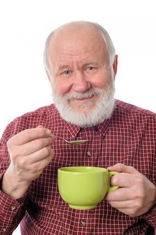 Vrolijke hogere mens met groene die kop, op wit wordt geïsoleerd