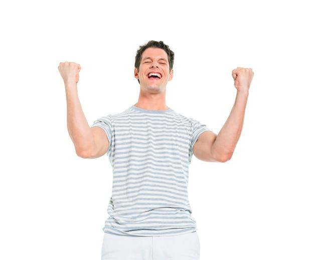 Vrolijke toevallige mens die overwinning vieren