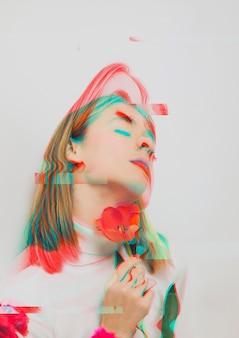 Vrouw die een papaverbloem in 3d effect houdt