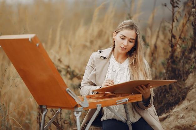 Vrouw in een bruine jas schilderij in een veld