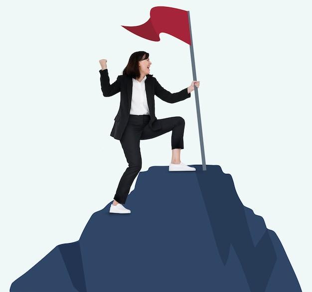 Vrouw met een vlag op de top van een berg