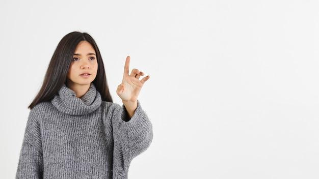 Vrouw met opgeheven wijsvinger