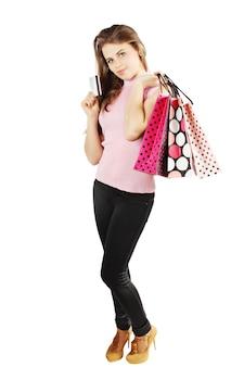 Vrouw met papieren zakken en een creditcard