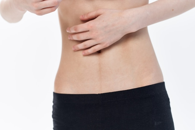 Vrouw met platte buik dieet anorexia gewichtsverlies. hoge kwaliteit foto