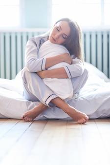 Vrouw op het bed
