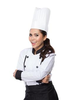 Vrouwelijke chef-kok in een traditionele hoed en jas