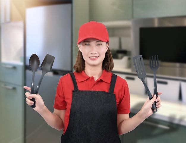 Vrouwelijke chef-kok of huisvrouw
