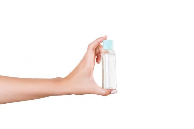 Vrouwelijke de holdingsfles van de handholding lotion
