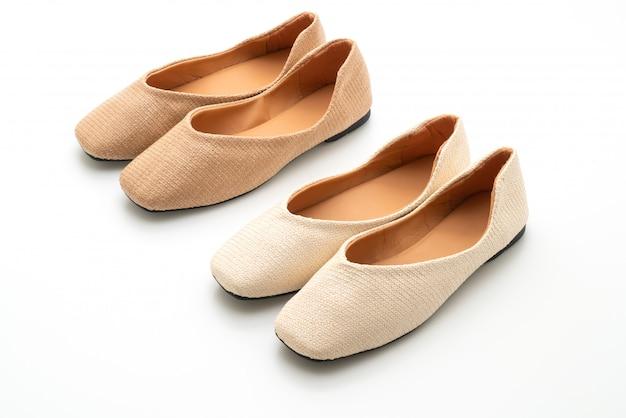 Vrouwelijke en vrouwelijke platte schoenen