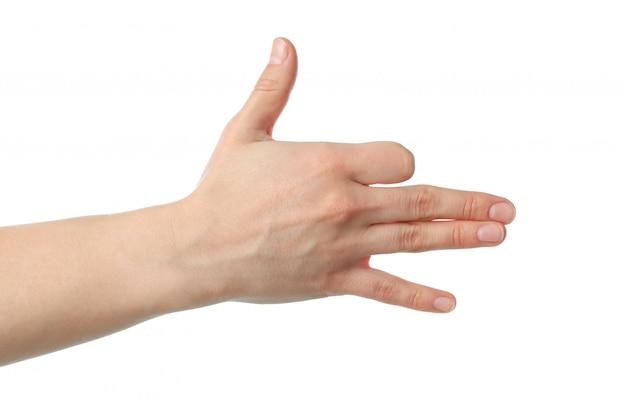 Vrouwelijke hand die gebaar toont, dat op witte achtergrond wordt geïsoleerd