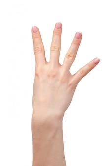 Vrouwelijke hand die vier vingers op wit toont