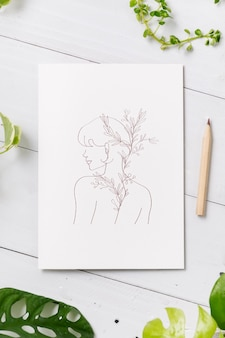 Vrouwelijke lijntekeningen op wit papier