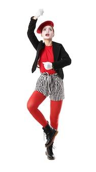Vrouwelijke pantomimist op witte achtergrond
