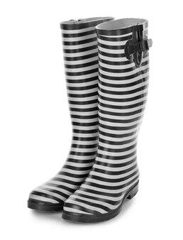 Vrouwelijke rubberen laarzen op wit