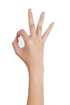 Vrouwenhanden die ok (teken) teken gesturing door achterkant op wit wordt geïsoleerd dat