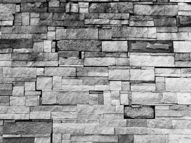 Vuile oude stenen muur voor achtergrond in zwart-wit fotografie