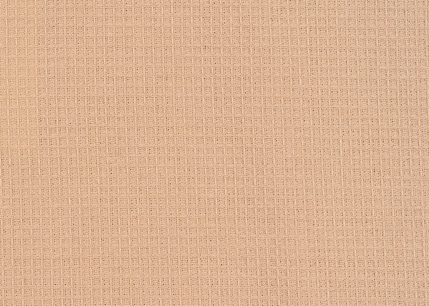 Wafel beige stof met zichtbare textuur kopie ruimte voor tekst, web print ontwerpelementen.