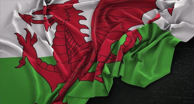 Wales vlag gerimpeld op donkere achtergrond 3d render