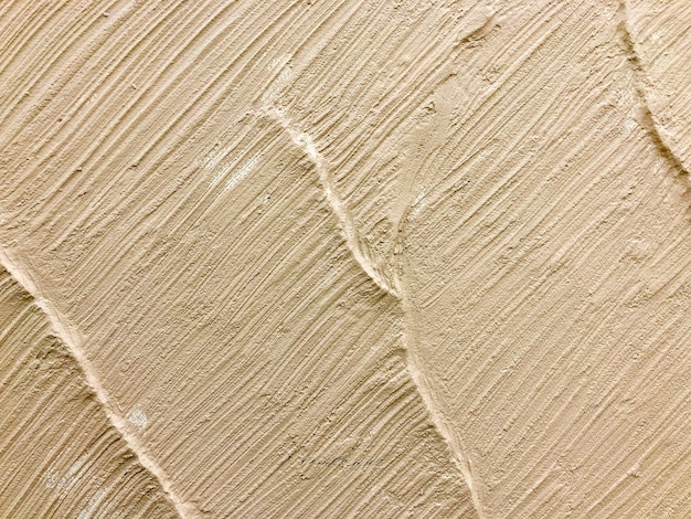 Wand textuur lichtbruin of crème kleur voor achtergrond.