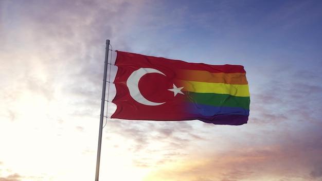 Wapperende nationale vlag van turkije en lgbt regenboogvlag achtergrond