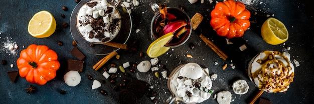 Warme dranken in de herfst, warme chocolademelk, pompoen latte, karamel en pindakoffie latte, glühwein