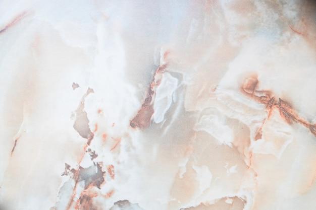 Warme gekleurde natuurlijke marmeren het materiaaltextuur / achtergrond van het paneel