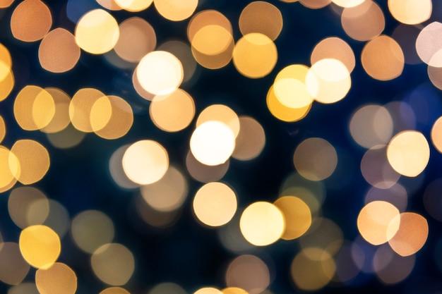 Warme gouden bokehlichten