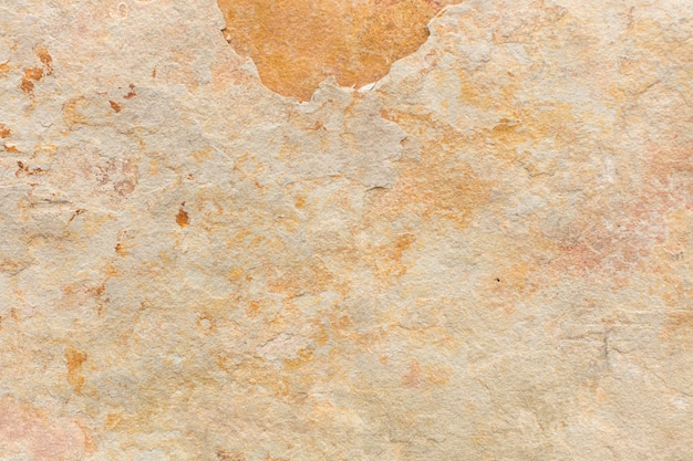 Warme kalksteentextuur of steenachtergrond.