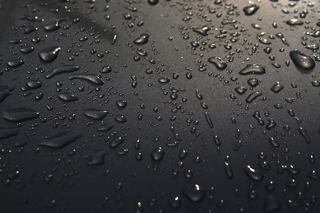 Waterdruppels op de auto oppervlak textuur achtergrond vloer
