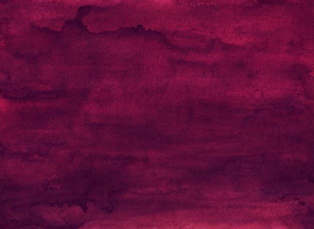 Waterverf het diepe karmozijnrode schilderen als achtergrond. oude aquarel donker bordeaux. vlekken op papier.