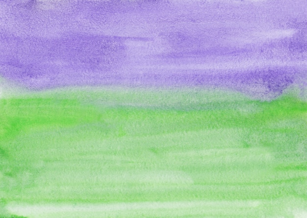 Waterverf lichtgroene en purpere het schilderen textuur als achtergrond