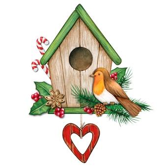 Waterverfvogelhuis kerstthema met rode robin