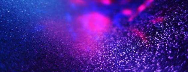 Wazig donkere abstracte achtergrond met glinsterende lichten bokeh ultraviolet glinsterende lichten