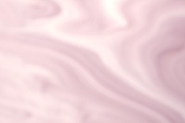 Wazig licht roze en witte achtergrond met golvende lijnen.