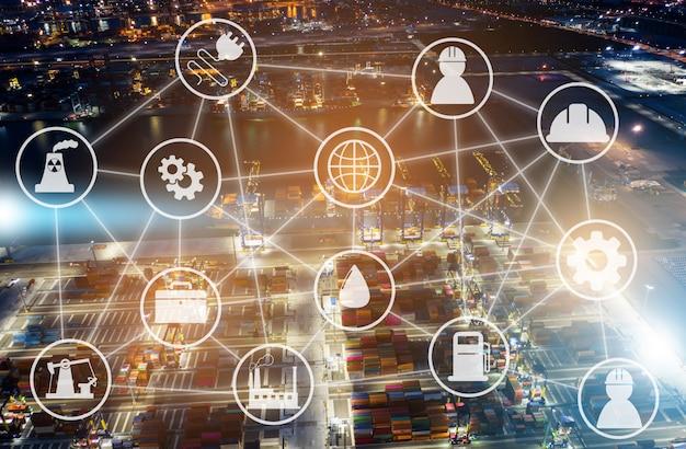 Wazig stad nacht met systeem pictogrammen diagram op industriële fabriek