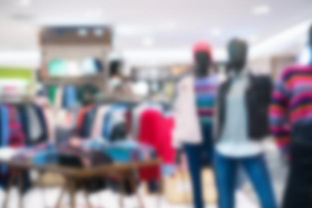 Wazig van kleding winkel in warenhuis om te winkelen