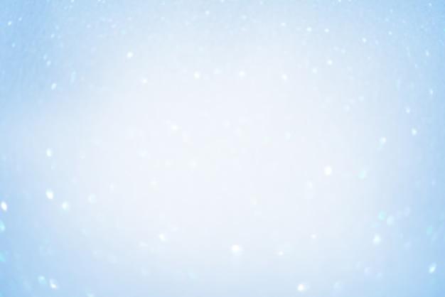 Wazige focus van blauwe sparkles. defocus licht wit en blauw glitter.