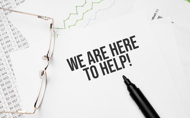 We zijn hier om te helpen . conceptuele achtergrond met grafiek, papieren, pen en bril