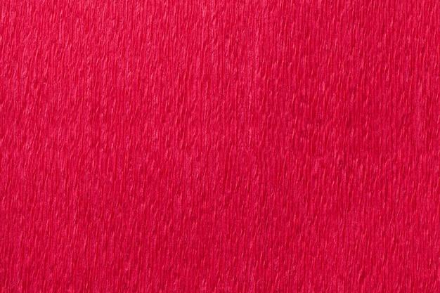 Weefsel heldere rode achtergrond van golvend golfdocument, close-up.