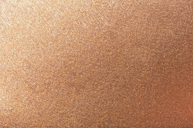 Weefsel van brons golvend golfdocument, close-up.