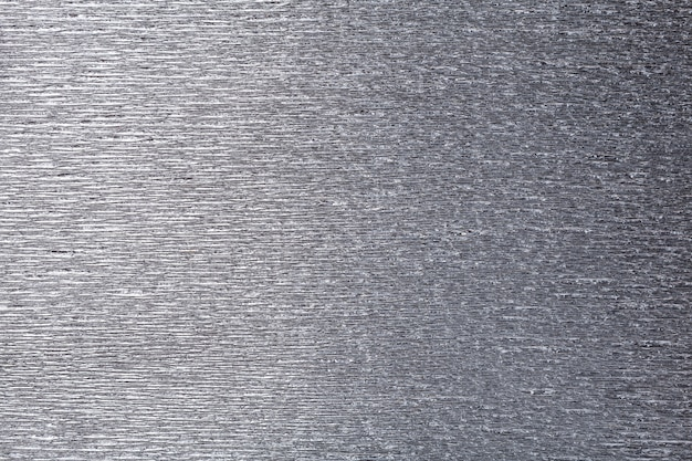 Weefsel van grijs golvend golfdocument, close-up.