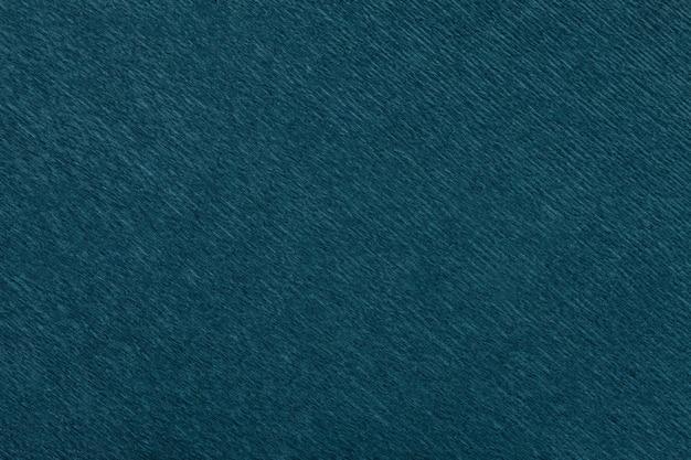 Weefsel van marineblauwe achtergrond van golvend golfdocument, close-up.