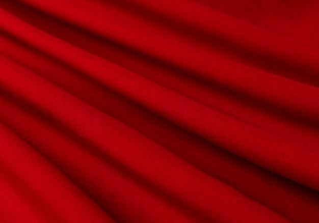 Weefsel, weefsel, textiel, doek, stof, webmateriaal golvende rode close-up textuur stof achtergrond